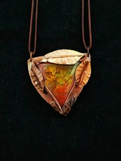 Check out this item in my Etsy shop https://www.etsy.com/listing/400087643/ammolite-handmade-faux-pendant-hand