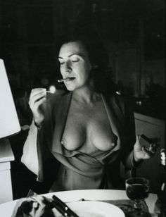 """by Helmut Newton of his wife June  """"We lived in Paris, we had an apartment in the Marais. We were having dinner at a bistro in the neighborhood. Helmut finished eating he asked me, 'June, you can open the?', Indicating the jacket. Obviously he had the camera on the table. I opened the jacket quickly. It was very fast."""" Adore"""