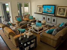 This 2008 entertainment room and home theater combines solid turquoise pillows with patterned cushions and the textures of wicker furniture and seashells.