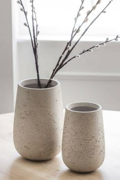 I love this modern and simple vase crafted from cement. The stone color will match well in any interior color scheme, with natural flecks and markings varying from piece to piece. A simple and modern way to display your flowers. #ad #concrete #vase #homedecor #cement #modern