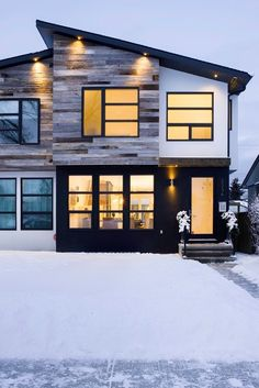 Calgary Residence by Beyond Homes. The sharp black lines provide a modern contrast with the surroundings!