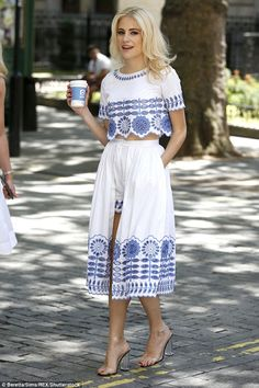 Lott-s of fashion ideas! Pixie Lott gave a modern twist to ladylike fashion on Monday, as she lapped up the London sunshine in a pretty white and blue ensemble