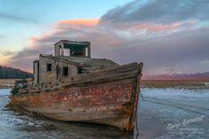 "Joe Redington's Boat ""Nomad"" at the Kink mud flats on the Cook Inlet near Wasilla Alaska."