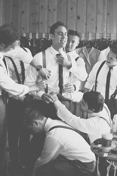 All the guys helping the groom get ready. Great photo. Anthem Photography.