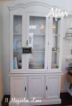 Paint a $30 Craig's List Hutch w/ BM Silver Bells, add in chicken wire for missing glass.  From 11 Magnolia Lane