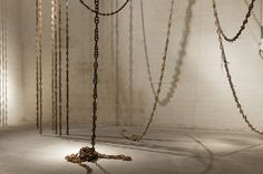 titled \'posidonia\', the artwork interprets the room as the subaquatic space of a dock, and visitors are invited to tie a little nylon string on the ceramic chains, creating a natural/man-made line of \'tide\'.