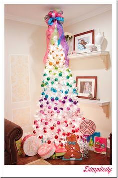 Rainbow themed colorful Christmas Tree with Disco Ball Bow topper