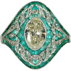Antique Garland Era Emerald and Diamond Dome Ring with 1.65ct Center Stone and 3.8cttw in Emeralds