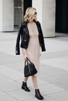 573965f2c5a2 Feminine nude tulle dress styled with edgy black leather moto jacket and  buckle boots