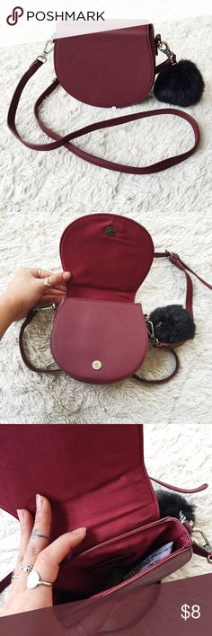 "🔻Burgundy Pom Pom Faux Leather Crossbody Purse🔻 NWOT🔻Burgundy Pom Pom Faux Leather Cross Body Purse🔻Bought this from Forever21 for a small ""going out"" bag after I ripped off the tags I realized my phone doesn't fit inside of it 😑 I have an iPhone6+🔻Never used this purse🔻so cute and would keep it but obviously I can't fit my phone in it and that's kinda the point of carrying a purse... Forever 21 Bags Crossbody Bags"