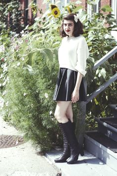 Shop this look on Lookastic:  http://lookastic.com/women/looks/white-bow-tie-white-cropped-sweater-black-skater-skirt-black-knee-high-boots/6325  — White Bow-tie  — White Knit Cropped Sweater  — Black Leather Skater Skirt  — Black Leather Knee High Boots