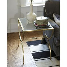 This gold side table would tie in with the mirror and i just love the soft feminine shape of the legs.