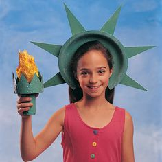 Liberty Crown and Torch:  -Green non-toxic washable paint  -Glitter  -Glue  -Paper plate  -Yellow tissue paper  -Poster board  -Scissors