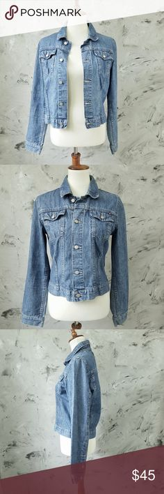 "Tommy Hilfager Denim Jean Jacket Fantastic Tommy Hilfiger Vintage Denim Jean Jacket In great condition. gently worn. Buttons in tact. Size Large 12 -14  Bust 36"" Waist 34"" Length 21' Shoulder 15"" Sleeve 25""  DISCLAIMER: This is a second hand vintage item and so being may come with some stains, wear or undetected defects. I have tried to describe and photograph each item so as to best represent the product. Additional pictures available upon request. Tommy Hilfiger Jackets & Coats Jean…"