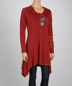 Combining flirty with functional, this circle-kissed tunic impresses! Draping sidetails give its silhouette grace, while a cozy hood and long, soft sleeves keep it totally cold-weather ready.