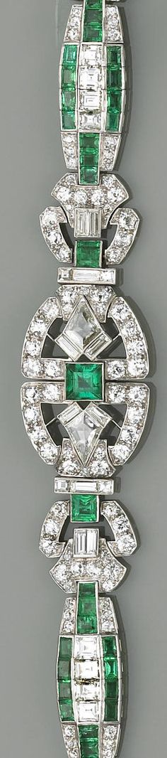 An art deco emerald, diamond and platinum bracelet  the central hinged plaque of openwork design, centering a square-cut emerald, flanked by kite-shaped diamonds, set throughout with old European, square, and baguette-cut diamonds, and accented by square and rectangular-shaped emeralds; estimated total emerald weight: 3.80 carats; estimated total diamond weight: 11.00 carats; length: 7in.