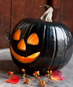 Paint pumpkin black with high gloss black paint and then carve