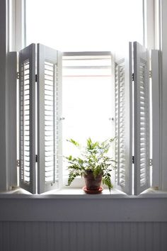 White plantation shutters. Cafe style, petite panels and thin louvers.  Simple and chic design.  www.sunkistshutters.com