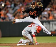 Style points -        Baltimore Orioles second baseman Rey Navarro leaps over Los Angeles Angels Mike Trout after getting a force at second in the sixth inning May 15 in Baltimore. Navarro's throw was off line, allowing the runner, the Angels' Albert Pujols, to advance to second base. The Angels won 3-1.  - © Gail Burton/AP