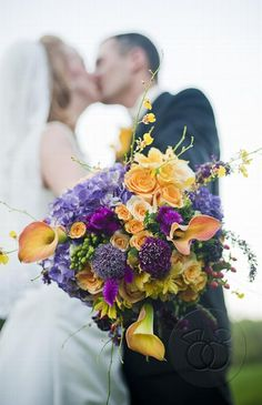 fall hues of purple and orange charming rustic bouquet