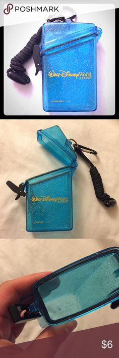 Disney Parks waterproof case Great condition, used once. Waterproof container bought from Disney's Blizzard Beach. Perfect for holding a small phone, keys, money, credit cards, room key cards, park map, chapstick, medicine, etc. Includes, key ring, clip, and cord lanyard attached at the top. Disney Accessories Key & Card Holders
