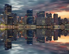 """Metropolis - The skyline at Circular Quay in Sydney as seen from the Opera house. It is a more colorful version of a previous post. The reflections were done in PS.  Feel free to follow me on  <a href=""""https://www.facebook.com/pages/Alexander-Riek-Photography/588013561261816"""">FACEBOOK</a>   or to visit my  <a href=""""http://www.photographichorizons.com"""">WEBSITE</a>"""