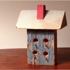 Miniature bird house made with recycled wood by my grandfather. I'm thinking of making some