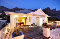 Palm Tree House, Camps Bay, is set against the backdrop of the magnificent Twelve Apostles mountain range.