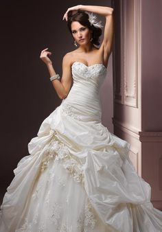 I love the detail of this dress! Gown features beading, lace, corset bodice and detachable cap sleeves.
