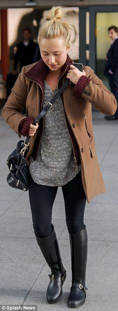Hayden stylish in black leggings and leather riding boots, paired with a simple beige sweater
