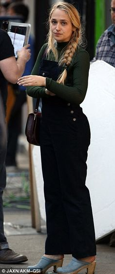 Chic: Jemima looked cool in black dungarees and a green roll-neck jumper with a suede cross-body bag and her hair in a side plait