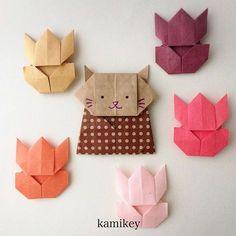 """実は「ねこびな」は一枚チューリップとして試作していたものをアレンジしてできたのでした^ ^「ねこびな」の作り方動画はプロフィールにリンクがあるYouTube""""のkamikey origami """"チャンネルでご覧ください ✳︎ I changed the tulips into the cat. Tulips (no tutorial ) Cat Hina Doll Designed by me tutorial on YouTube"""" kamikey origami"""" #折り紙#origami #ハンドメイド#kamikey"""
