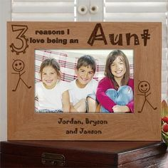 Cute personalized Aunt photo frame features up to 10 names of her nieces and nephews.