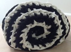 Spiral black and white crochet pillow