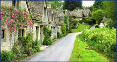 This is Arlington Row, in the town of Bibury and the county of Gloucestershire in England