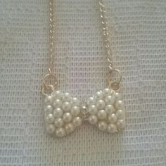 New bow necklace New faux pearls rhinestone gold tone bow necklace so cute 2 available price is for 1 Jewelry Necklaces