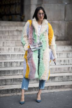 Eva Chen seen wearing a colorful fur coat and a Chanel bag in the streets of Paris after the Stella McCartney fashion show during the Paris Fashion...