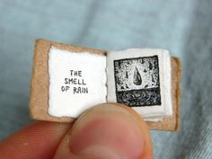 Miniature Book Of 'Life's Lil Pleasures' Evokes The Smell Of Rain balloons old books on the library shelf bird chirps riding on the back of shopping carts getting that thing unstuck from between your teeth What else? Book Art, Up Book, Book Of Life, Small Drawings, Doodle Drawings, Doodle Art, Mini Books, Libros Pop-up, Smell Of Rain