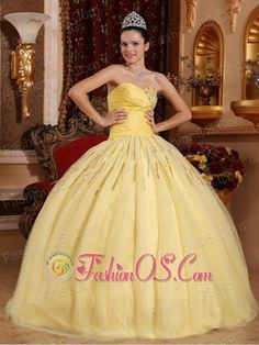 Beautiful Light Yellow Quinceanera Dress Sweetheart Tulle Beading Ball Gown http://www.fashionos.com This amazing yellow quinceanera dress will have you feeling and looking like royalty. It features a one strap bodice that's embellished with pleats.The puffy skirt is long and flowing and pools in a lovely puddle at your feet. The simple, yet intricate designs in this gown will surely make it a favorite.