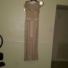 Adrianna Papell MOB Dress Champagne-colored dress overlaid with lace beautiful for mother of the bride or any formal event. Wore once to my daughter's wedding don't need to wear it anymore, still in like new condition. I'm five foot eight and I was able to wear it with heels. Adrianna Papell Dresses Wedding