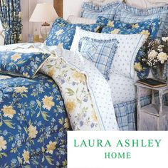 Add this printed comforter set to your space to create a truly romantic environment. This Laura Ashley design is a classic, and the blue and yellow print is vibrant and lovely. The set includes the comforter, bed skirt, and two pillow shams.