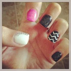 Nail design. All in one. Black and white chevron design. Black glitter pink shimmer white color and gems. Super cute and pretty.