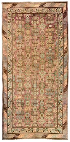 A Samarkand rug BB4399 - An early 20th century Samarkand (Khotan) rug, the dusty rose field with a trellis overall of angular vinery ...