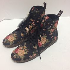 "Dr. Martens Shoreditch Floral Canvas Boots Authentic new without box a floral canvas hybrid of combat boot and high-top sneaker. Featuring the brand's trademark ""Air Wair"" cushioning and branded pull tab. Canvas upper with seven-eyelet lacing system. ""Air Wair"" cushioned rubber sole. Branded fabric pull tab. Color: Black with floral design. Dr. Martens Shoes Combat & Moto Boots"