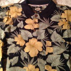 Mens Tommy Bahama XL Polo Shirt Mens Tommy Bahama XL Polo Shirt. Short Sleeve, 3 Button Collar, Left Breast Pocket, 100% Cotton Tommy Bahama Tops Tees - Short Sleeve