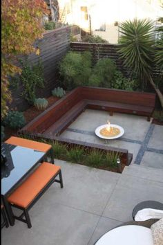 Drought tolerant plants, large concrete pavers and rocks make for a sleek, modern and low maintenance patio.