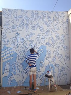 The artist Forrest Perrine, doing a mural on the studio wall.