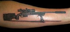 Sniper Rifle . Custom Tattooing by Ainslie Heilich of Vintage Karma tattoo studio in Tuscola, IL. More info at artofvintagekarma.com