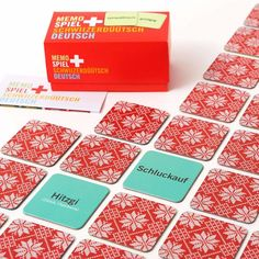 Memospiel Schweizerdeutsch - Deutsch Wortpaare | Bestswiss.ch Container, Gift Wrapping, Games, Memory Games, Creative Design, Packaging, Cards, Gift Wrapping Paper, Wrapping Gifts