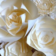 Paper Flowers in Ivory. You can design your own gorgeous paper flower wall. Special orders are welcome. www.paperflora.com
